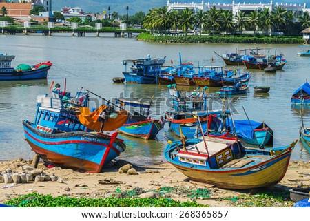 Fishing boats in marina at Nha Trang, Vietnam - stock photo