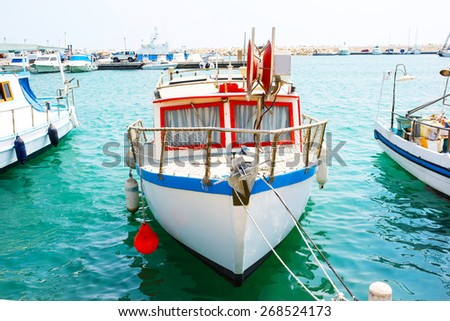 Fishing boats in old port in Mediterranean sea - stock photo