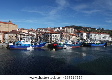 Fishing boats in Orio. Blue fishing boats attacked at Orio port, small town in Guipuzcoa, Basque country, North Spain - stock photo