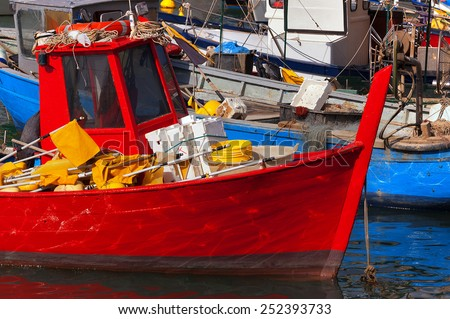 Fishing Boats in the Harbor - Liguria Italy. Small fishing boats with fishing equipment docked in the port - Lerici, La Spezia, Liguria, Italy - stock photo