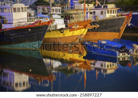 Fishing boats in typhoon shelter in Hong Kong  - stock photo