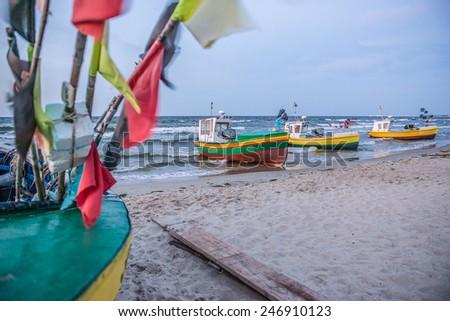 Fishing boats on Baltic Sea beach in Karlikowo District in Sopot, Poland - stock photo