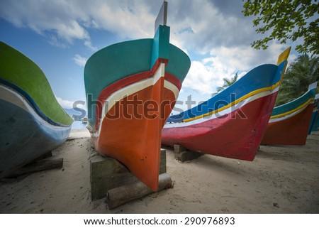 Fishing boats on sandy beach  - stock photo