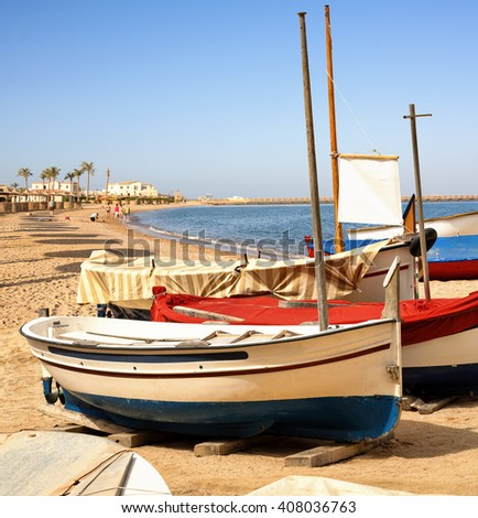 Fishing boats on the beach. - stock photo