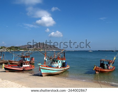 fishing boats on the beach, at Koh Chang, Thailand - stock photo