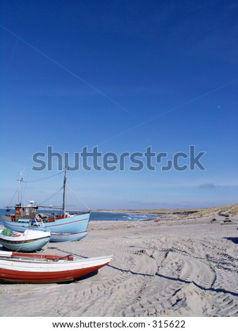 Fishing boats on the beach at Vorupore in western Jutland, Denmark. - stock photo
