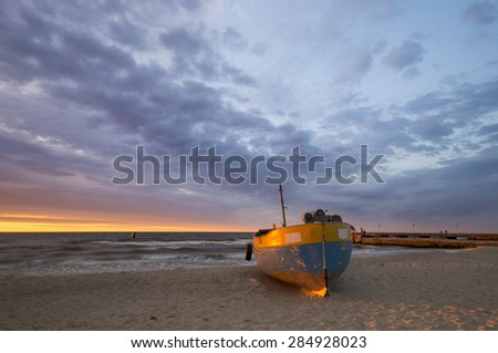 Fishing boats on the beach during a storm  - stock photo