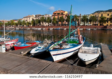 Fishing boats on the river in Bosa in Sardinia - stock photo