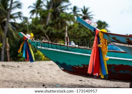 Fishing boats on the sea shore Thailand - stock photo