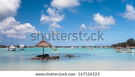 Fishing boats on the water at Grand Baie in Mauritius - stock photo