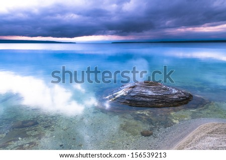 Fishing Cone - geyser in the West Thumb Geyser Basin at Sunrise - stock photo