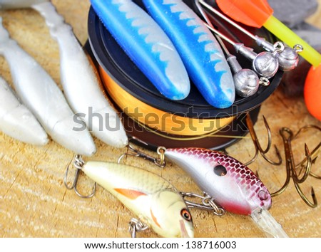 Fishing equipment on wooden - stock photo