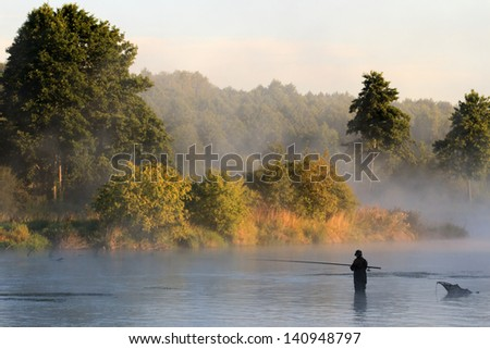 fishing, fishing in a lake, nature series - stock photo