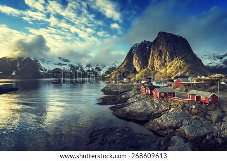 Fishing hut at spring sunset - Reine, Lofoten islands, Norway - stock photo