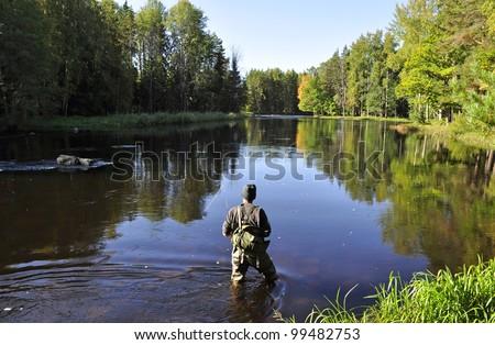 Fishing in river - stock photo