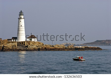 Fishing in the early morning near Boston Harbor lighthouse. It is the oldest beacon in New England. - stock photo
