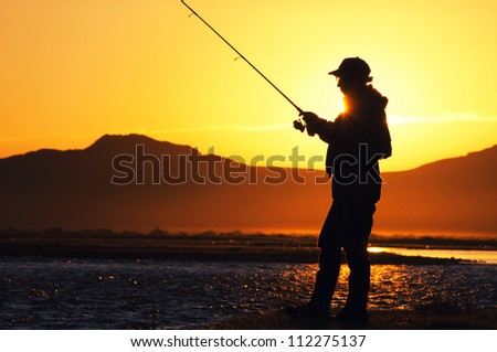 Fishing in the Mongolia - fisherman silhouette - stock photo