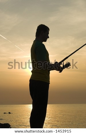 fishing man - stock photo