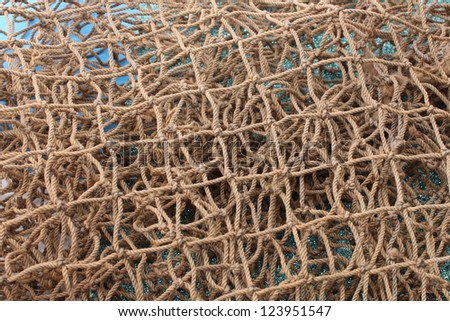 Fishing net and sea shells - stock photo