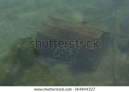 fishing net,fish trap under the sea,fishery in sea,trap model, - stock photo
