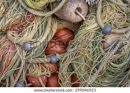 Fishing net in the port of a Ligurian fishing village - stock photo