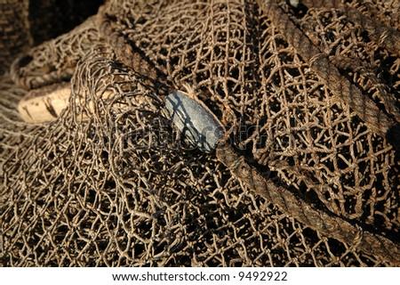 Fishing net is drying in the sun. - stock photo