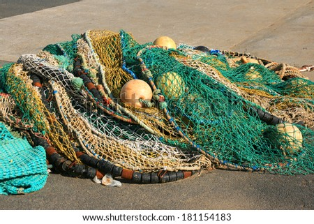 Fishing net on a dock. - stock photo