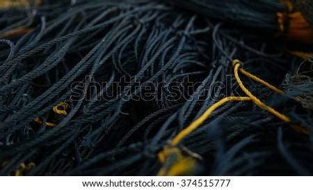 Fishing nets closeup. selective focus of fishing nets . Fishing net use by fisherman to caught lot of fish during the trip to the sea - stock photo