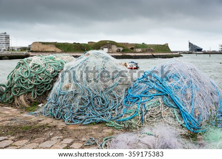 Fishing nets on dock port - stock photo