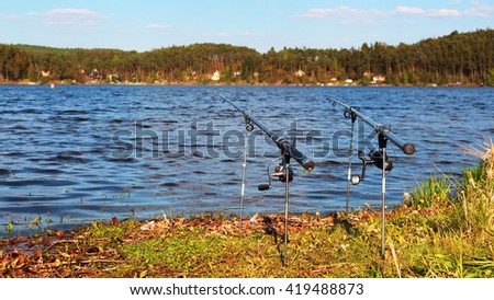 Fishing on a lake. Fishing rods ready to catch big fish. Hracholusky dam, Czech republic, European Union. - stock photo