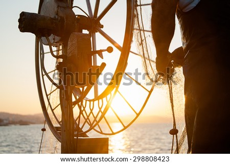 Fishing on boat in sea - stock photo