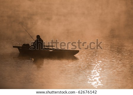 Fishing on the river in the morning - stock photo