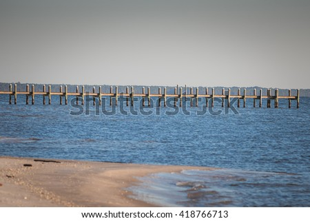 Fishing pier in Gulf of Mexico - stock photo