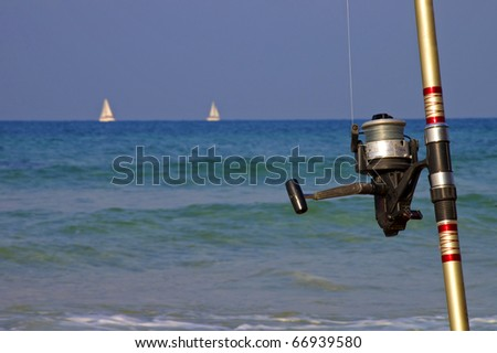 Fishing rod in the foreground - stock photo