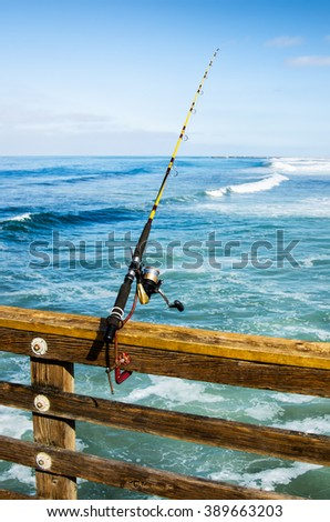Fishing rod on the pier, close up - stock photo