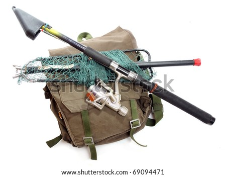 Fishing rod with reel and landing net with a back-pack. - stock photo