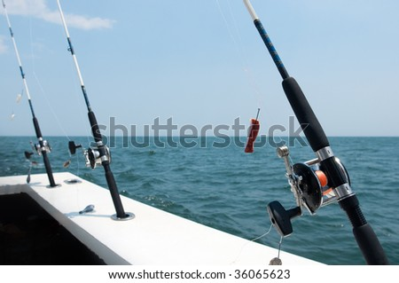 Fishing rods at the rear of a boat - stock photo