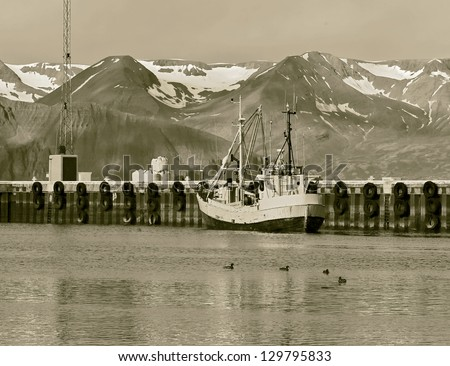 Fishing schooner in the port of Reykjavik city, Iceland (stylized retro) - stock photo
