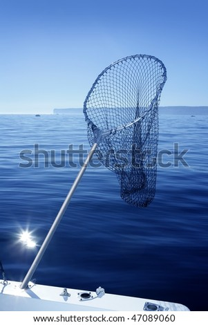 Fishing scoop net on boat with blue sea ocean background - stock photo