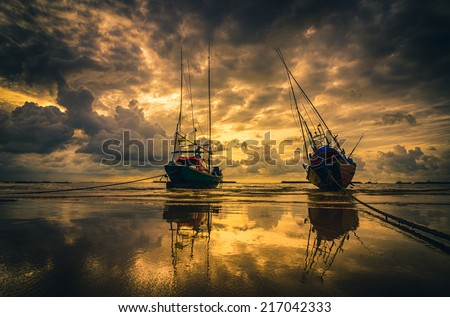 Fishing sea boat and Sunrise clouds before strom in Thailand gold light tone vintage - stock photo