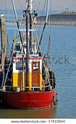 fishing ship moored on quay - stock photo