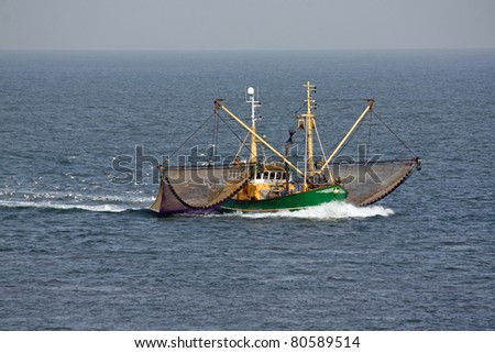 Fishing ship on sea - stock photo