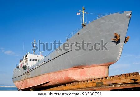 fishing ship on the stocks - stock photo