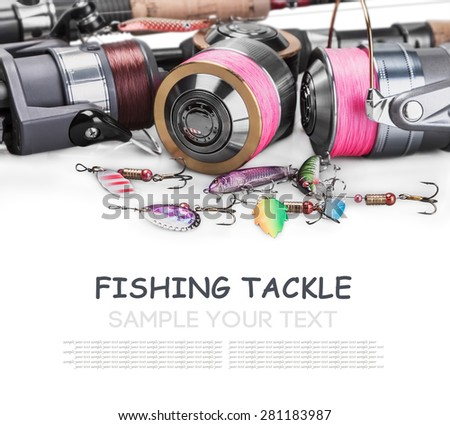 Fishing Tackle Spinning isolated on white background. Focus on a reel with a pink braided fishing line and lures convent... - stock photo
