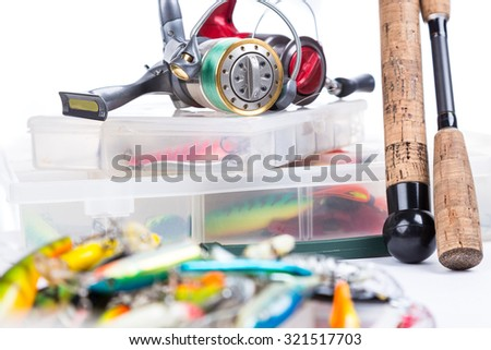 fishing tackles, fishing lure and fishing bait on plastic storage boxes on bright white background. for design advertising or publication - stock photo