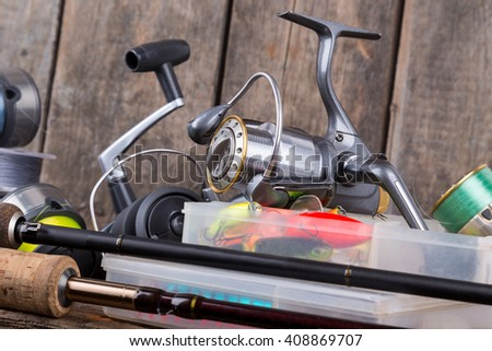 fishing tackles on vertical wooden board background. Concept design for fishing sport business - templates, web, poster, card, ets. - stock photo