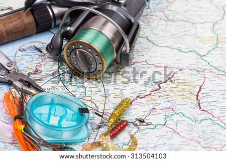 fishing tackles - rod, reel, line and lure on norway map background. Prepare fishing  route and to journey - stock photo