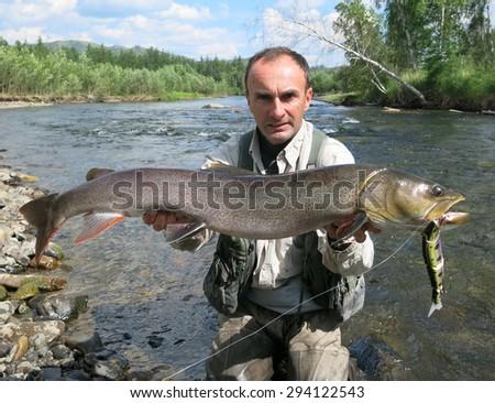Fishing (Taimen fishing in Mongolia) - stock photo