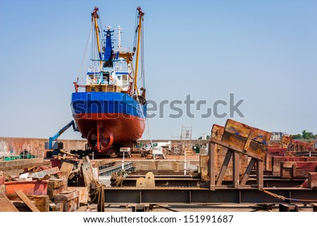 Fishing trawler in a drydock - stock photo