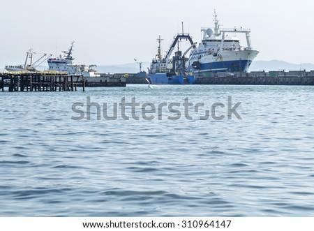 Fishing trawler near a mooring - stock photo